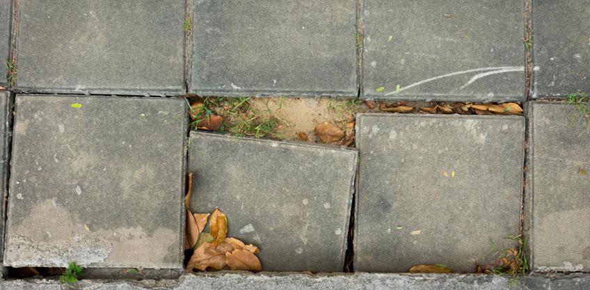 clogged gutters sidewalk driveway cracks